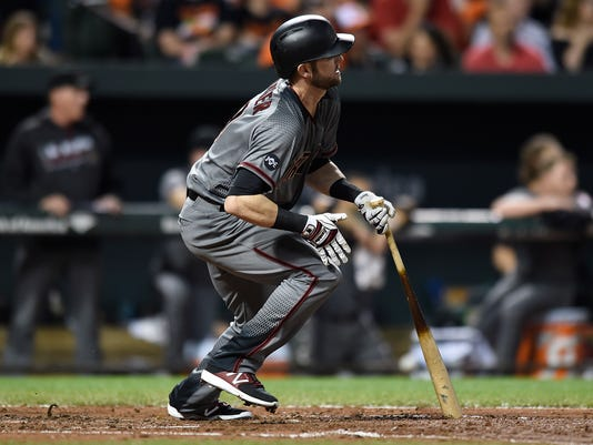Arizona Diamondbacks' Mitch Hanlger follows through on a single against the Baltimore Orioles in the fifth inning of a baseball game, Saturday, Sept. 24, 2016, in Baltimore. The Orioles won 6-1. (AP Photo/Gail Burton)
