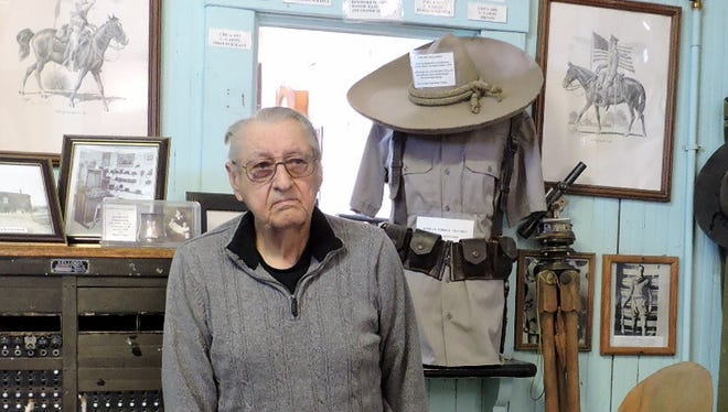 The Columbus Historical Society has been responsible for maintaining the remnants of the past since the 1970s. Society president, Richard Dean stands in a museum display room that contains memorabilia from the time of the Pancho Villa raid on the town.