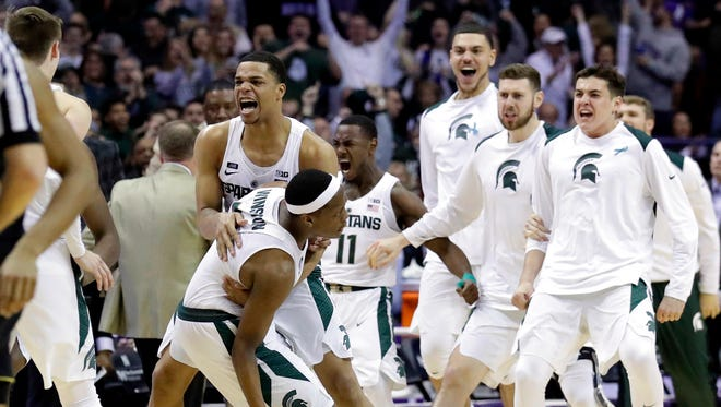 Michigan State Michigan State guard Cassius Winston, left, celebrates with guard/forward Miles Bridges after scoring a basket during the second half of an NCAA college basketball game against Northwestern, Saturday, Feb. 17, 2018, in Rosemont, Ill. Michigan State won 65-60.