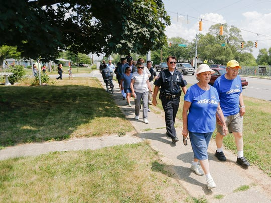 A couple joins the public safety walk Wednesday.