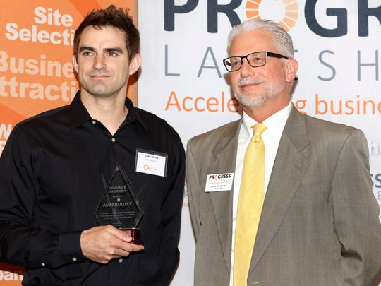 Luke Check, left, of Americollect, receives the Corporate