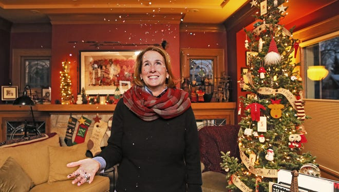Frankie Suzanne Garr tosses a handful of confetti in her living room. For years, the Wauwatosa woman has slipped confetti into cards she sends to people. On New Year's Eve, she will help disperse confetti on revelers in Times Square.