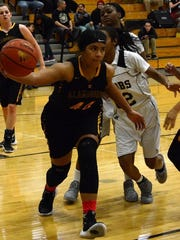 Jerraysha Smith drives the lane Wednesday night during the District 4-6A semifinal at the Ralph Tasker Arena.