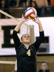 Abilene High's Ashley Pierce (4) sets the ball during a 2015 match for the Lady Eagles. Pierce is now a senior setter at Hardin-Simmons.