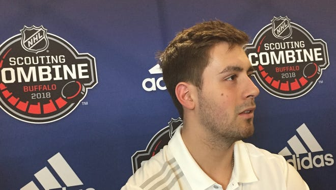 NHL draft prospect Evan Bouchard speaks at the NHL combine in Buffalo, N.Y. on Friday.