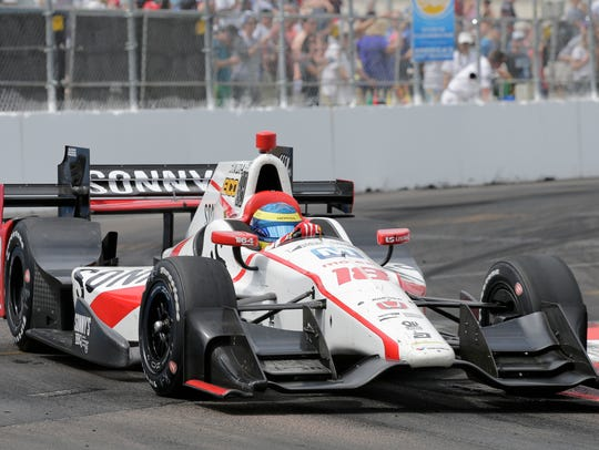 Sebastien Bourdais, of France drives into turn 10 during