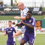 Louisville City's Kadeem Dacres (7) goes up for a header against a Montreal player Wednesday night during the first half. Aug. 5, 2015