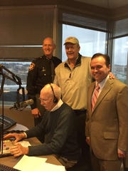 Hamilton County Sheriff Jim Neil, ex-Bengal Bob Trumpy and Mayor John Cranley at Jim Scott's last morning show.