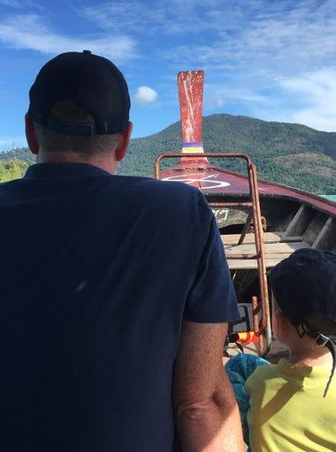 Derek and Walker Hughey on a longboat between Thai islands Ko Lipe and Ko Adang.