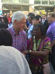 Bill Clinton walks in the Labor Day parade in Detroit