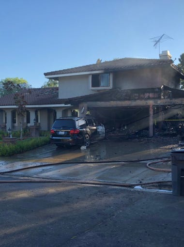 Crews from Ventura County Fire continued to work on a house fire in the 300 block of Valley Gate Road in Simi Valley Monday morning.