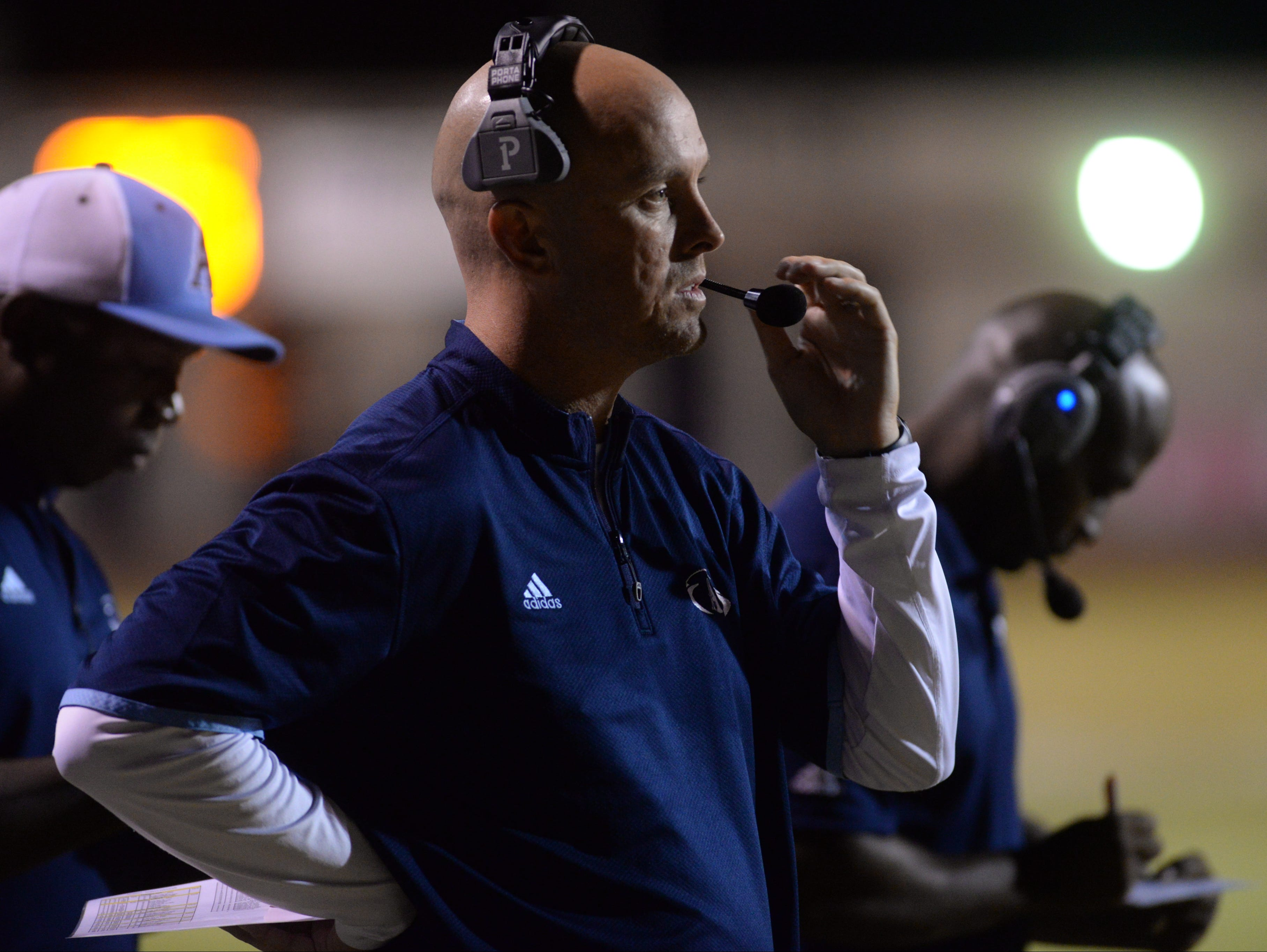 Bo Meeks, head coach of Airline, watches his team from the sideline.
