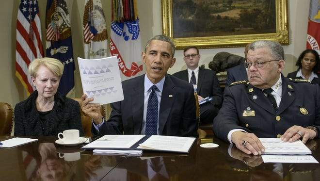 President Obama with members of his task force on 21st Century policing.