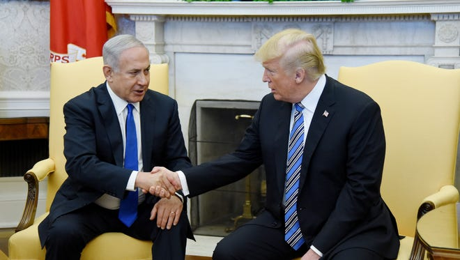 President Trump shakes hands with Israel Prime Minister Benjamin Netanyahu as they meet in the Oval Office on March 5, 2018.