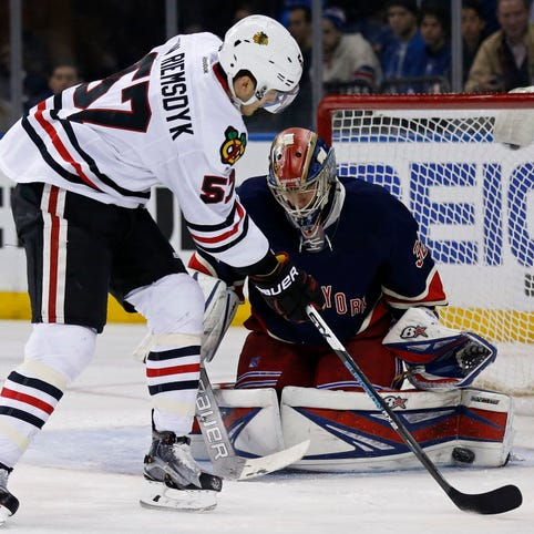 Rangers goalie Antti Raanta (32) makes a save againt