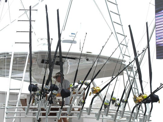 A crew member of the Kallianassa from Naples, Fla., waits for the scales to open at  the White Marlin Open. The boat brought in the winning fish, but the tournament has declined to pay out the $2.8 million prize, saying several crew members failed polygraphs.