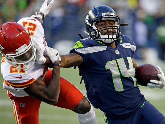 Seattle Seahawks' J.D. McKissic (14) pushes away Kansas City Chiefs' Eric Murray on a kick return during the second half of an NFL football preseason game, Friday, Aug. 25, 2017, in Seattle. The Seahawks won 26-13.