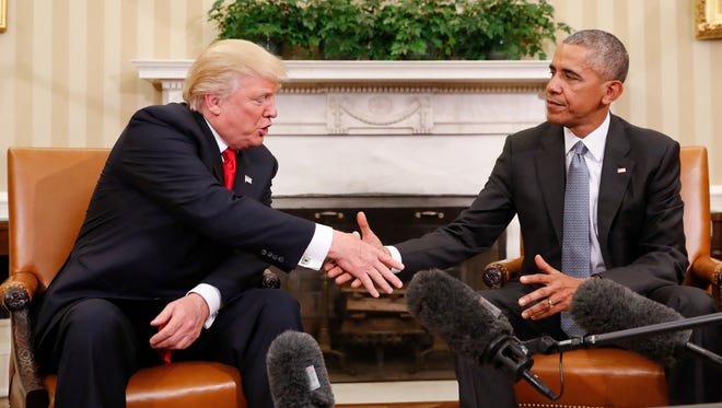 President Barack Obama and President-elect Donald Trump shake hands after their meeting in the Oval Office of the White House in Washington Thursday.
