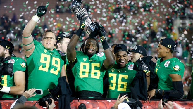 Oregon players -- including linebacker Torrodney Prevot, No. 86, and running back Kani Benoit, 36 -- celebrate their win over Florida State in the Rose Bowl.