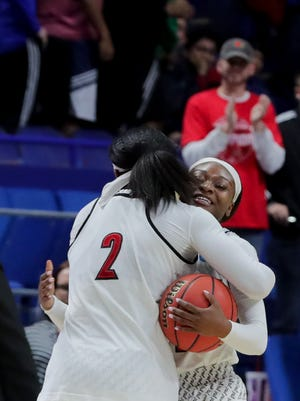 Louisville's Myisha Hines-Allen and Dana Evans hug after the Cards defeat Stanford 86-59 in the NCAA Sweet Sixteen.