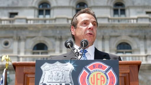 New York Gov. Andrew Cuomo speaks during a rally by New York City police and firefighters pushing for increased disability benefits outside the Capitol on June 10, 2015, in Albany. On Sunday, he signed a bill to expand health insurance for volunteer firefighters.