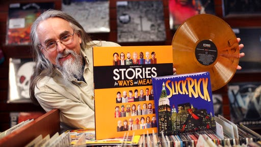 Chris Brown poses with and an orange vinyl recording of Stories for Ways and Means and Slick Rick's The Great Adventures of Slick Rick, a 7-inch single packaged in a board book, at Bull Moose Music in Portland, Maine, Friday, April 14, 2017. Brown, a Bull Moose employee, hatched the idea for Record Store Day that that started with 200 stores ten years ago. About 1,600 record stores are expected to participate on Saturday.