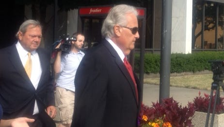 John Gizzi, at left, leaves the federal building in July after a court appearance.