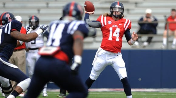 Ole Miss quarterback Bo Wallace throws a pass during Saturday's Grove Bowl.