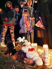 About 50 people attend an emotional vigil at 6:30 p.m. Monday, Jan.19, 2015, for 13-year-old Ashton Harting, who was fatally shot in the early morning hours on the Far Eastside. Harting was found on the sidewalk in the 3600 block of Decamp Drive after neighbors reported shots fired.