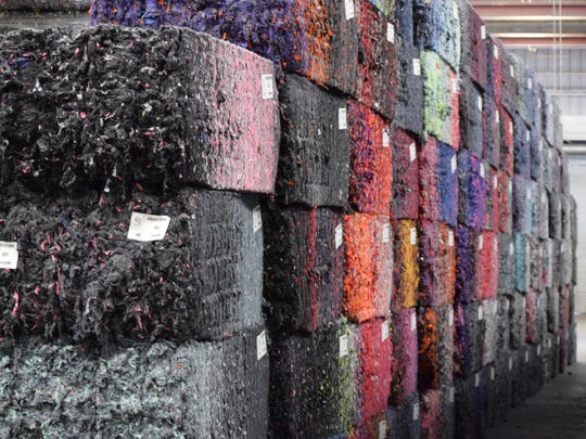 Colorful fiber bales reflect the vibrant textiles they