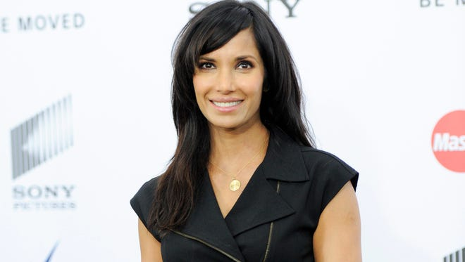 """TV personality Padma Lakshmi attends the world premiere of """"Annie"""" at the Ziegfeld Theatre in New York on Dec. 7, 2014. Though Lakshmi loves exploring exotic foods on her show and in her travels, she grew up a strict vegetarian in India and follows a mostly vegetarian diet when she's not filming."""
