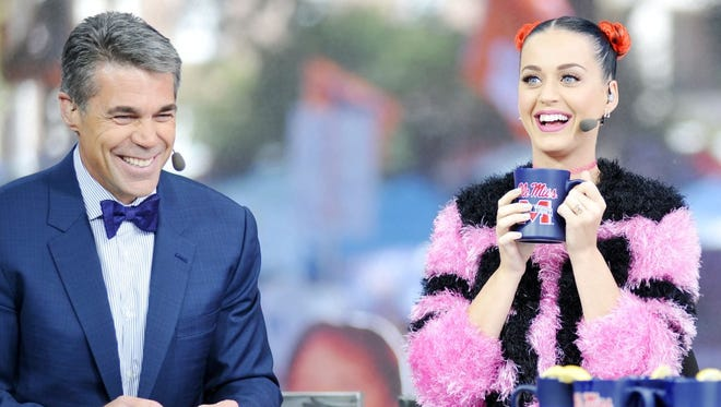 Singer Katy Perry, right, joins host Chris Fowler, left, during a telecast of ESPN's College Game Day  at the University of Mississippi prior to their NCAA college football game in Oxford, Miss., on Oct. 4.