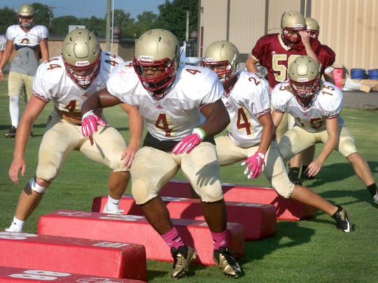 Riverdale football player Kentrell Green leads the other players through an agility drill as part of practice, at the school, on Monday July 25, 2016, during the first official day in football pads for the season.