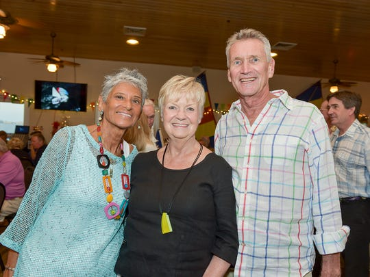 """Generous Sailing Center supporters and volunteers Stephanie Zinger, left, Linnea Desmond and Mike Gorny at the 2018 """"Ports of Call"""" gala in Jensen Beach."""
