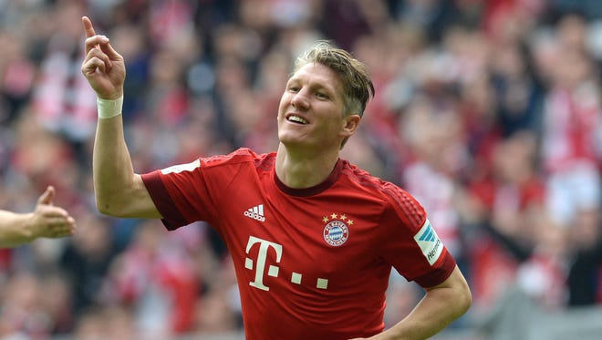 Bayern Munich's midfielder Bastian Schweinsteiger celebrating after the second goal during German first division Bundesliga football match FC Bayern Munich vs 1 FSV Mainz 05 at the Allianz Arena in Munich, southern Germany.