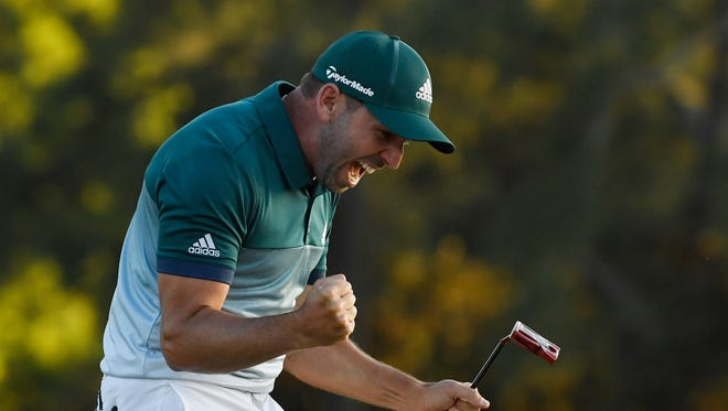 Sergio Garcia celebrates after making a putt on the 18th green during the first playoff hole to win the Masters on April 9.