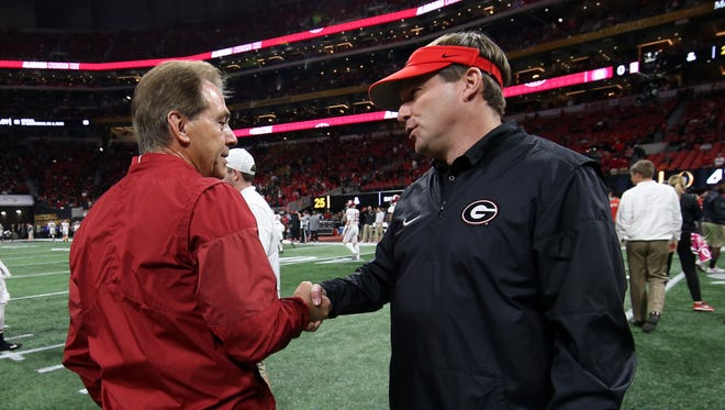 Alabama coach Nick Saban shakes hands with Georgia coach Kirby Smart before the Crimson Tide's 26-23 overtime win in January's CFP national championship game in Atlanta's Mercedes-Benz Stadium. The two coaches and their teams will meet again in the same place on Dec. 1 in the SEC title game.