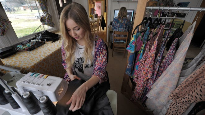 Savannah McNeill sews at her home in Nashville. McNeill and friend Casey Freeman are trying to take their Hey Wanderer brand to the next level by raising money via crowdfunding website Kickstarter to produce their clothing and fabric on a larger scale at an American manufacturing facility.