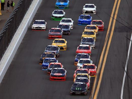 NASCAR Xfinity Series driver Kyle Busch (54) leads