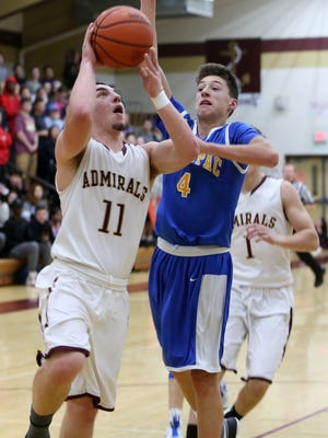 Arlington's Zach Dingee takes a layup in front of Mahopac's Zack Puckhaber at Arlington High School on Jan. 12.