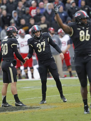 Kicker Paul Griggs (37) celebrates with holder Thomas Meadows after connection on a 52-yard field goal against Wisconsin at 13:53 in the third quarter Saturday, November 8, 2014, at Ross-Ade Stadium. The Boilermakers fell to the Badgers 34-16.