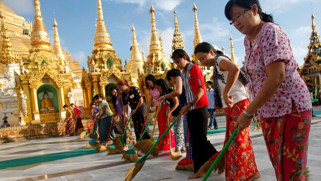 A group of women sweep an area at Myanmar's Shwedagon Pagoda.