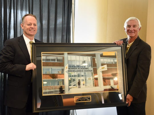 Southern Miss athletic director Bill McGillis, left, and former football coach Jeff Bower pose for photos at the announcement of plans for the Bower Academic Excellence Center in July 2015.