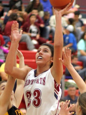 Junior Lady Cat post Vanessa Garcia (33) shares time on the floor with three other post players.The Deming High girls' basketball team has enjoyed recent success since concentrating on working the ball inside to the post players.