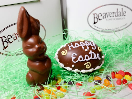 A marshmallow creme-filled bunny (left) and decorated milk chocolate Easter eggs filled with assorted candies are popular seasonal items at Beaverdale Confection Co. in Des Moines.