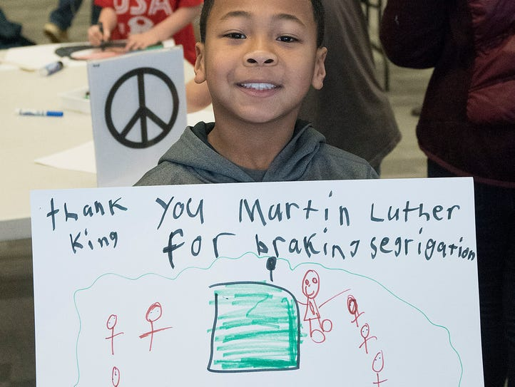 Calvin Stevens shows his sign, thanking Dr. King.