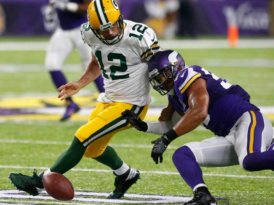 Green Bay Packers quarterback Aaron Rodgers (12) fumbles the ball in front of Minnesota Vikings outside linebacker Anthony Barr, right, during the second half of an NFL football game Sunday, Sept. 18, 2016, in Minneapolis. (AP Photo/Jim Mone)