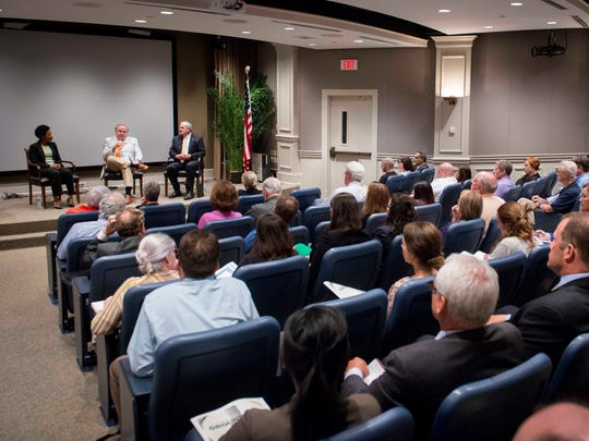 Guests listen as Dr. Mitchell Mutter, center, medical director of special projects for the Tennessee Department of Health, speaks during the Tennessean's opioid community discussion at the First Amendment Center, Wednesday, June 15, 2016, in Nashville.
