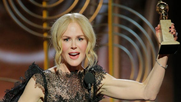 Nicole Kidman accepts her Golden Globes trophy for