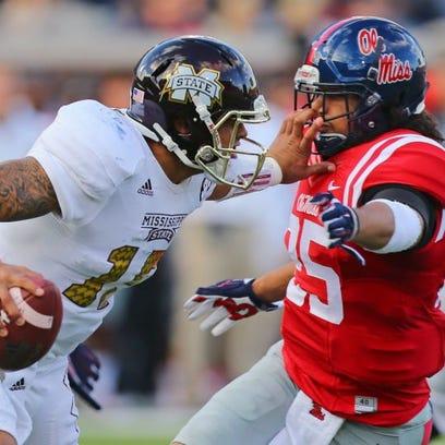 Mississippi State quarterback Dak Prescott prepares